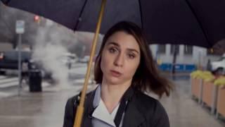 Unhappy Woman With Umbrella In Rain