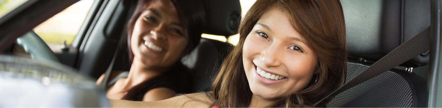 Driver And Passenger Smiling