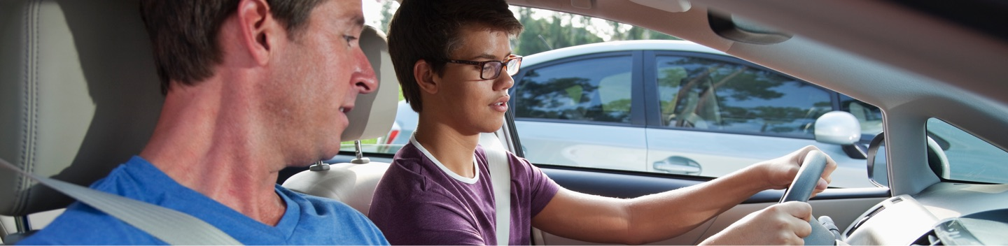 Student Driver And Instructor In Car